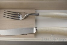 pair of Noble cutlery, ivory resin